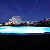 Hotel Resort Casteldoria Mare notturno piscina